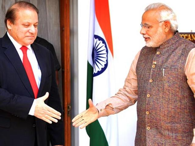 """PMModi with Pakistan Prime Minister Nawaz Sharif. Apparently referring to Pakistan, Modi said that """"some neighbours"""" don't understand that problems can be resolved peacefully with talks."""