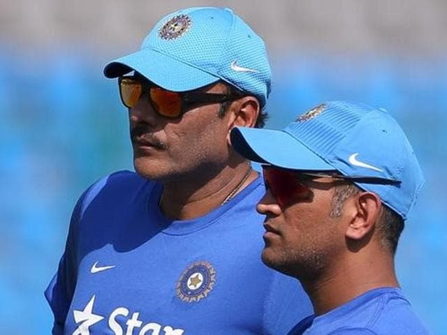 Ajinkya Rahane takes a close look at the pitch as skipper MS Dhoni and team director Ravi Shastri observe from a distance at a practice session ahead of the ICC World T20 semifinal match against the West Indies in Mumbai on Wednesday.