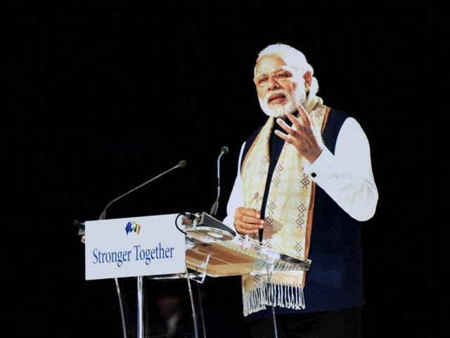 Prime Minister Narendra Modi addresses the public at a community reception in Brussels, Belgium, on Wednesday.