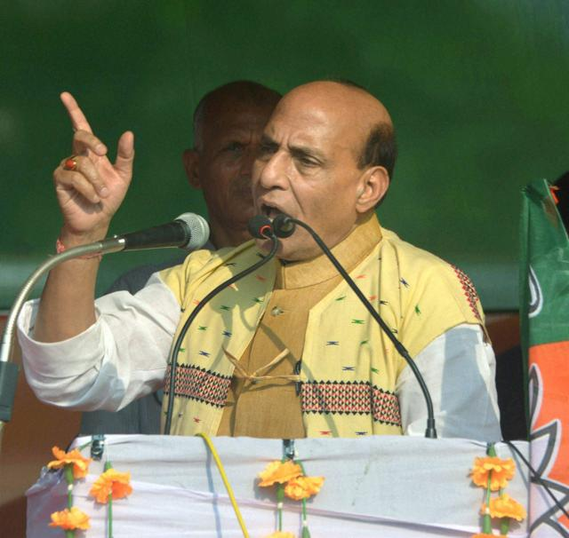 Union home Minister Rajnath Singh addresses an election rally at Gorudhoria village in Dibrugarh on Wednesday, March 30, 2016.