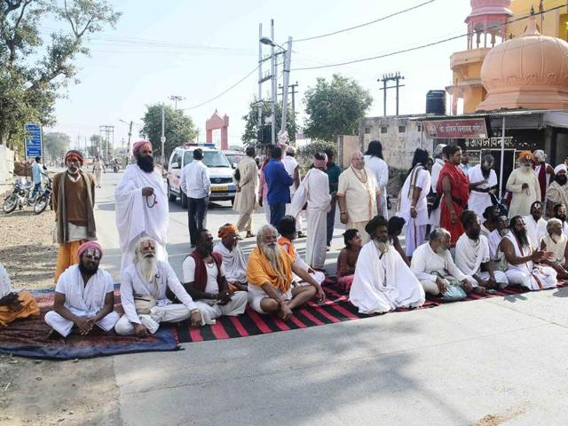 Saints of khaki akhara stage a road blockade to protest against poor facilities at Simhastha fair at Khak Chowk in Ujjain on Tuesday.