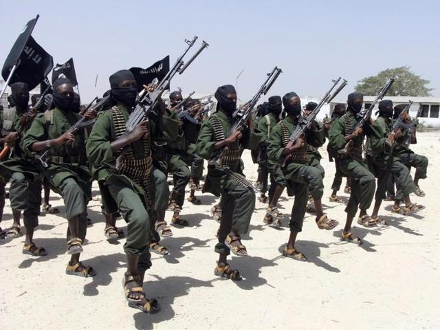 Hundreds of newly trained al-Shabab fighters perform military exercises in the Lafofe area, some 18 kilometers (11 miles) south of Mogadishu, in Somalia.