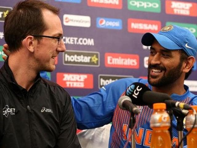 Speaking at a news conference after his team's loss to West Indies in the World T20 semifinal on Thursday, Dhoni invited a foreign journalist on to the stage before answering a question over plans to hang up his boots.