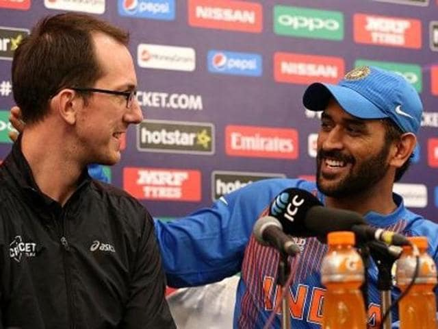 Speaking at a news conference after his team's loss to West Indies in the World T20 semifinal on Thursday, Dhoni invited Samuel Ferris on to the stage before answering a question over plans to hang up his boots.