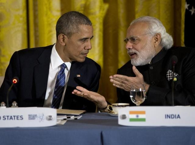 Prime Minister Narendra Modi interacts with US President Barack Obama during a dinner with heads of delegations of the Nuclear Security Summit at the White House.