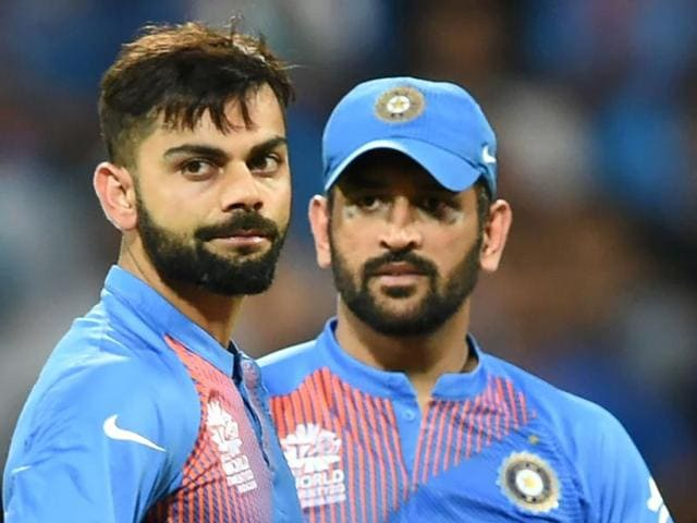 India's Virat Kohli and captain Mahendra Singh Dhoni look on after defeat in the World T20 cricket tournament.