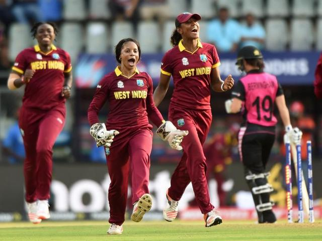 West Indies players celebrate after winning the World T20 cricket tournament women's semi-final match.