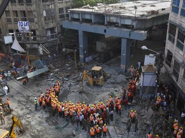 The partially constructed overpass had spanned nearly the width of the street and was designed to ease traffic through the densely crowded Bara Bazaar neighbourhood in Kolkata.