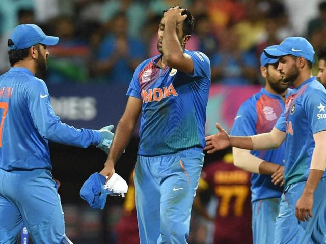 Indian players look dejected after they lost to West Indies.