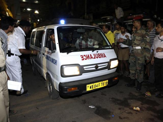 An ambulance with a dead body recovered from a partially collapsed flyover makes its way towards hospital in Kolkata.