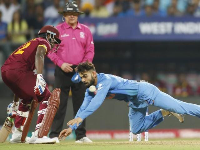 India's Virat Kohli fields the ball during their ICC World Twenty20 2016 cricket semifinal match against the West Indies at Wankhede stadium in Mumbai, Thursday, March 31, 2016.