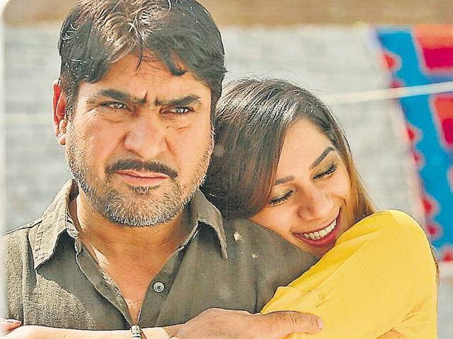 Actors Yash Pal Sharma and Nargis Nandal in a still from Haryanvi movie 'Satrangi'.