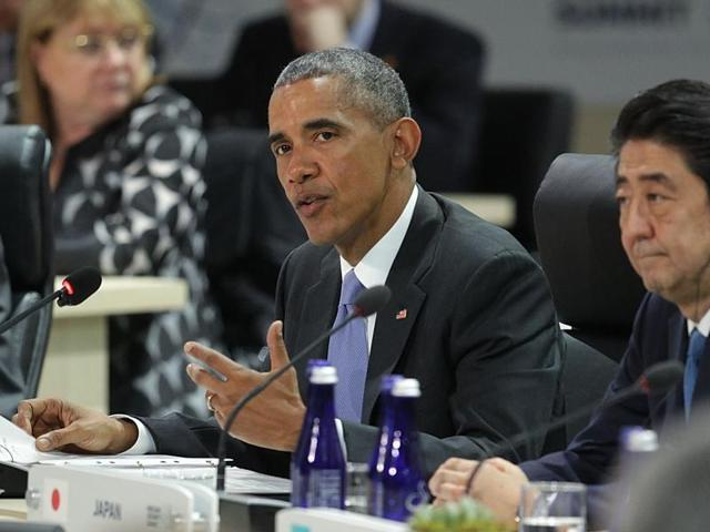 US President Barack Obama with French President Francois Hollande(L) and China's President Xi Jinping in a P5+1 meeting during the Nuclear Security Summit in Washington DC on Friday.