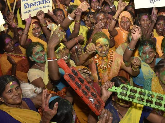Women dance and sing in Patma after a partial ban on the sale of liquor was enforced in Bihar.(AP Dube/HT Photo)