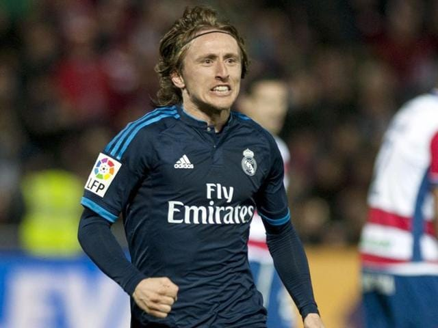 Real Madrid's Croatian midfielder Luka Modric celebrates a goal during the Spanish league match against Granada FC.