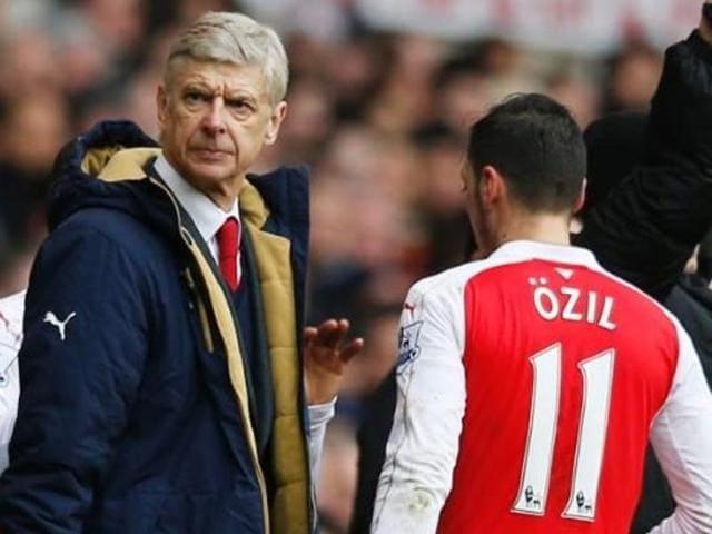 A file photo of Arsene Wenger and Mesut Ozil.