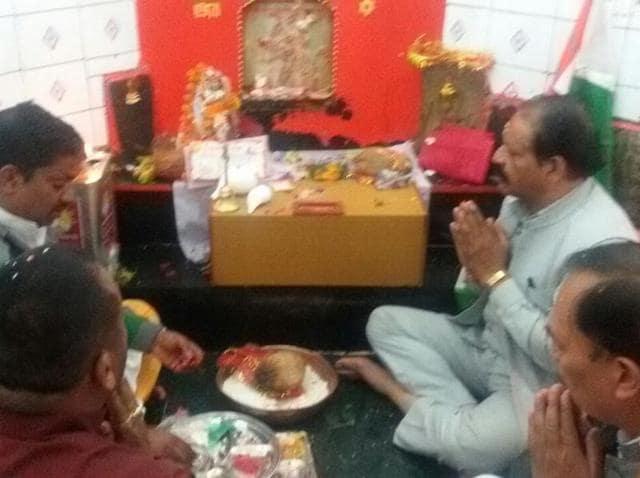 Congress leaders Khazan Pandey and Dinesh Kunjwal pray at Golu Temple Chital, Almora.