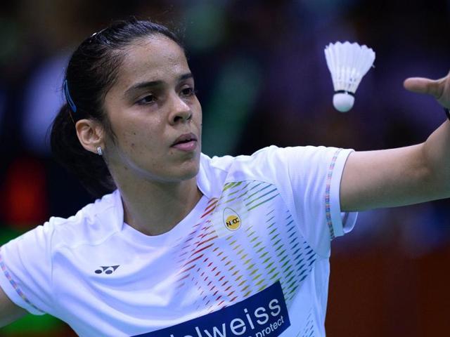 India's Saina Nehwal serves during her women's singles semi-final match against China's Li Xuerui.