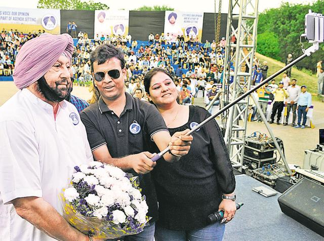 Students taking a selfie with Punjab Congress chief Capt Amarinder Singh during Coffee with Captain' in Chandigarh on Friday.