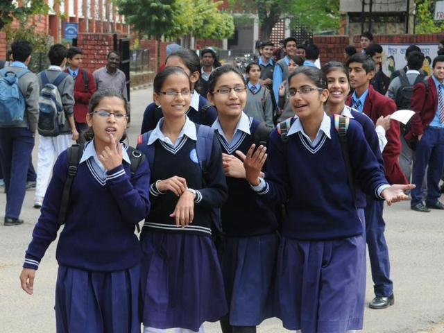 Students leaving a government school after appearing in the annual examinations in Chandigarh.