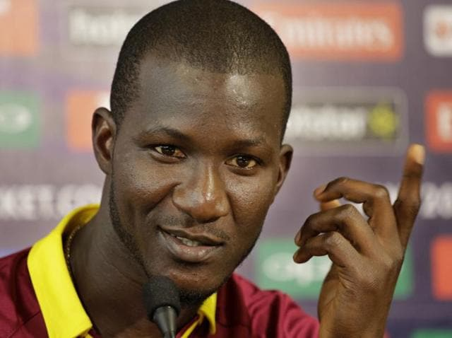 West Indies' captain Darren Sammy reacts while addressing a press conference.