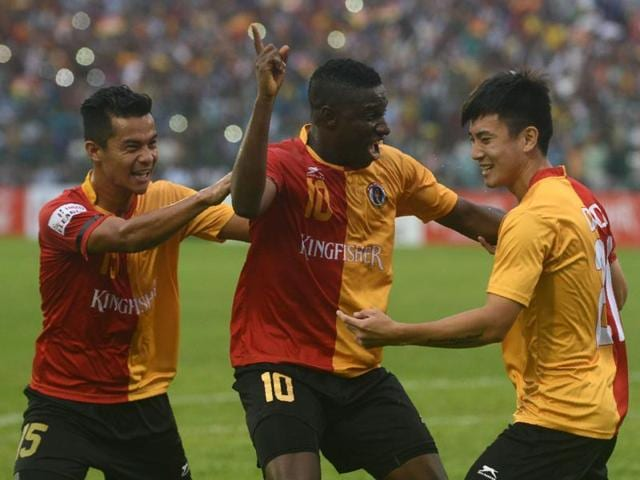 East Bengal's Do Dong and Sanju Pradhan celebrate after Do Dong scored during an I-League football match.