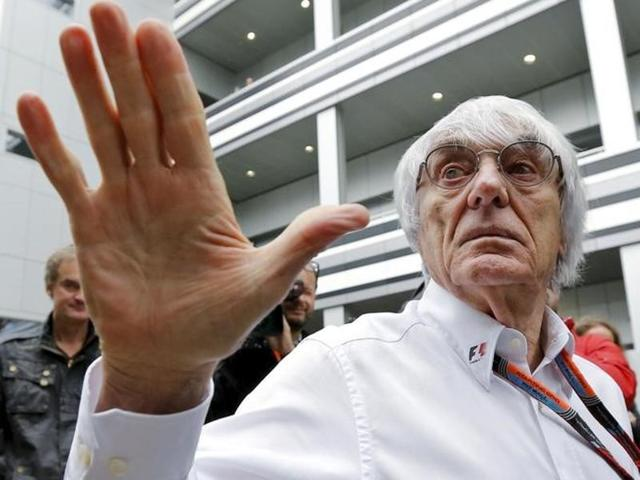 Formula One Chief Executive Bernie Ecclestone  reacts next to Former Formula One champion Niki Lauda.