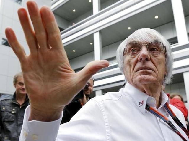 Formula One Chief Executive Bernie Ecclestone  reacts next to Former Formula One champion Niki Lauda.