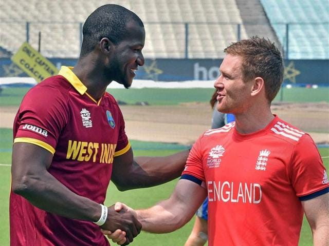 West Indies Captain Darren Sammy with England captain Eoin Morgan greets each other in Kolkata.