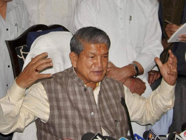 Harish Rawat was reportedly shown black flags and his convoy was pelted with stones in Dehradun .