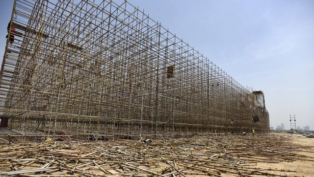 The stage used during the World Culture Festival organised by Sri Sri Ravi Shankar's Art of Living being disassembled near Yamuna flood plain in New Delhi.