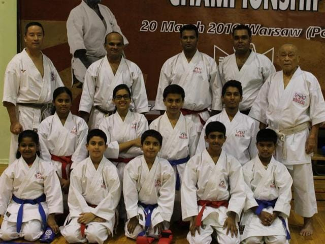 Participants pose with the medals and trophy they bagged at the European IKA Gosoku-ryu Karate Championship.