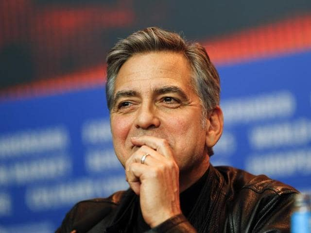 Celebrity magazine Hello! has apologized to George Clooney for running an interview that the star says was