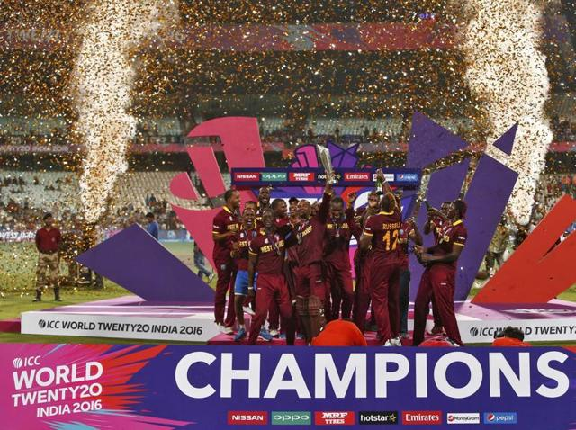 West Indies captain Darren Sammy and teammates celebrates with the World T20 trophy after beating England in the final at the Eden Gardens in Kolkata on April 3, 2016