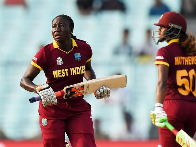 West Indies captain Stafanie Taylor holds the cup as she celebrates with team-mates at the Eden Gardens in Kolkata on Sunday.