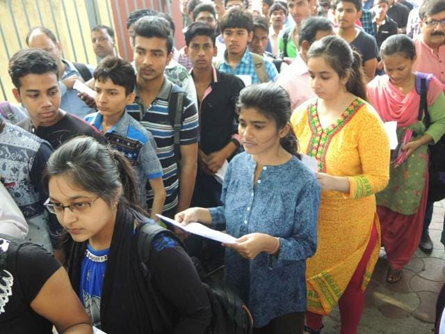 Students going inside exam center to take JEE (Main) exam, parents wished good luck and blessed their childrens as they walk exam hall in Lucknow India on Sunday.