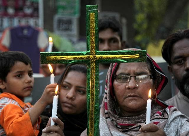 Pakistani Christians hold candles during vigil for the victims of Sunday's suicide bombing, at close to bombing's site in Lahore.