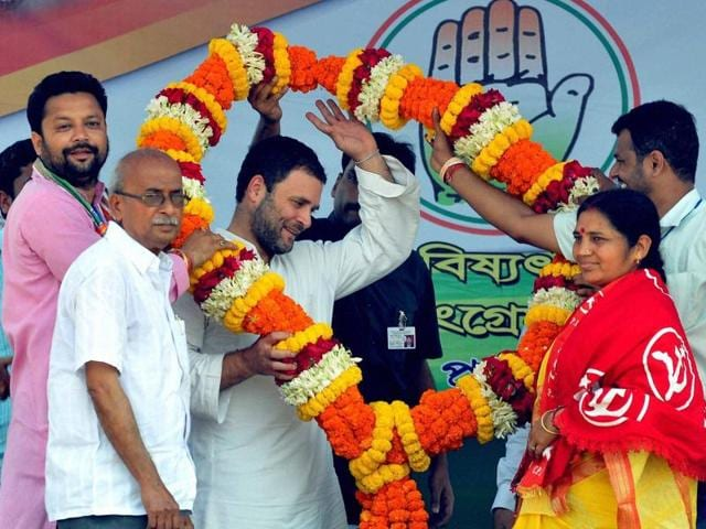 Congress vice-president Rahul Gandhi being garlanded by Congress as well as Left Front workers during an election campaign at Niyamatpur in Burdwan district of West Bengal on Saturday.