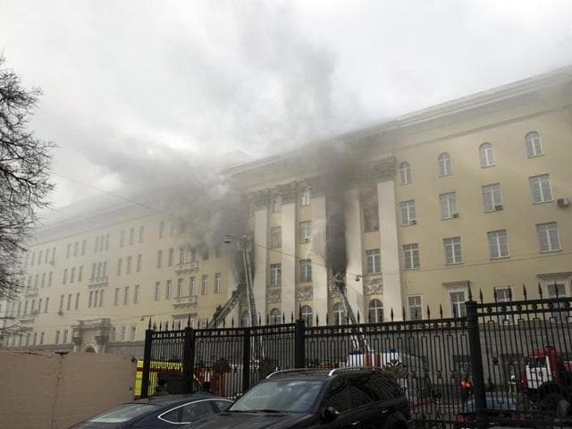 Firefighters work to put out a blaze at a building of Russian defence ministry in Moscow.