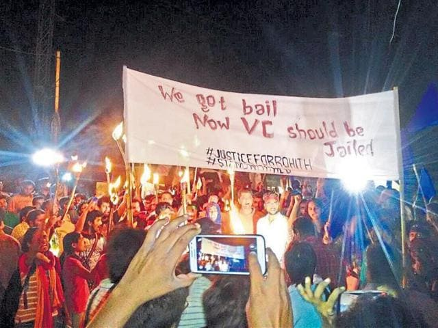 Students with banner call for Hyderabad University vice-chancellor Appa Rao's arrest.