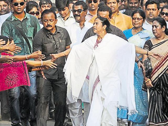 Trinamool president and West Bengal chief minister Mamata Banerjee greets supporters at a campaign rally in Bankura on Sunday.(Subhankar Chakraborty/HT Photo)