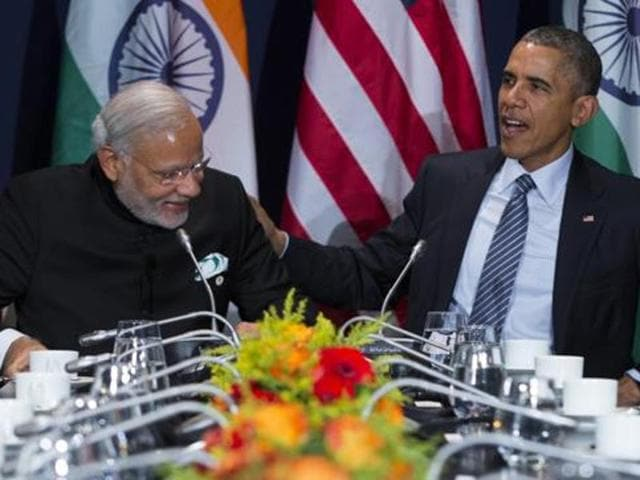 Prime Minister Narendra Modi interacts with US President Barack Obama during the COP21, United Nations Climate Change Conference, in Le Bourget, outside Paris.