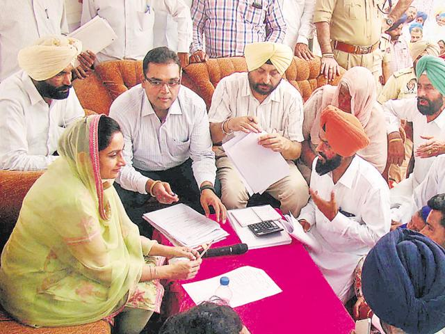 Union minister of food processing and Hoshiarpur MP Harsimrat Kaur Badal addressing a gathering during a sangat darshan at a village in Bathinda on Sunday.