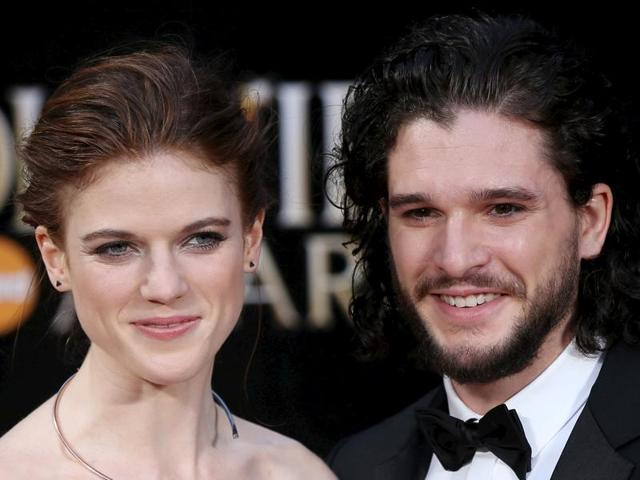 British actors Kit Harington (R) and Rose Leslie pose for photographers as they arrive at the Olivier Awards at the Royal Opera House in London, Britain, April 3, 2016. REUTERS/Neil Hall TPX IMAGES OF THE DAY