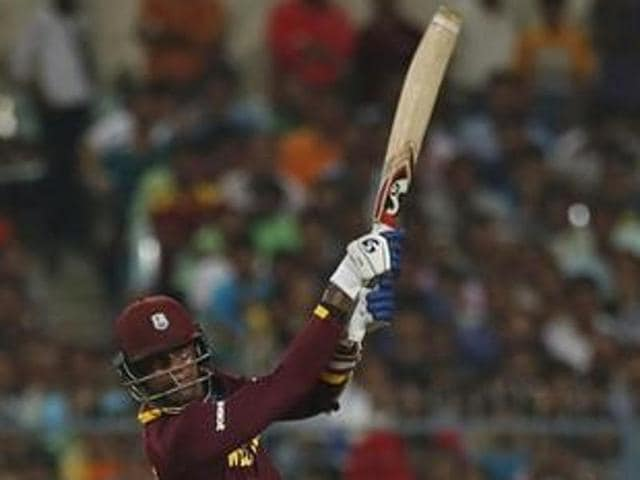 Marlon Samuels' grounded catch by Jos Buttler proved costly for England.