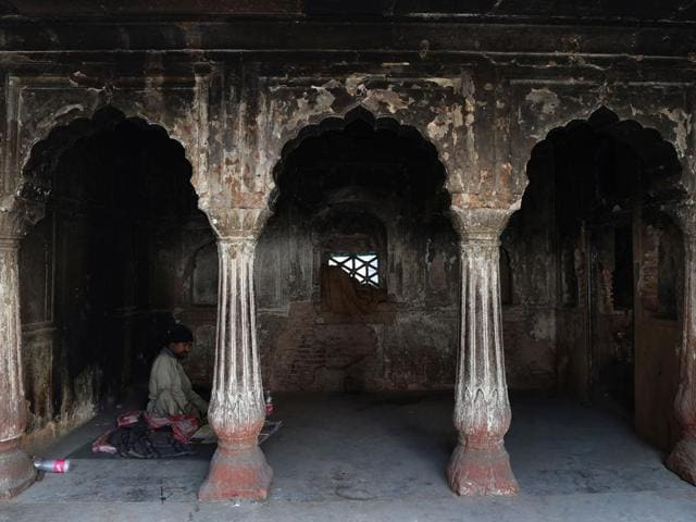 An Indian man sits inside the tomb of Atgah Khan in the Nizamuddin area of New Delhi.