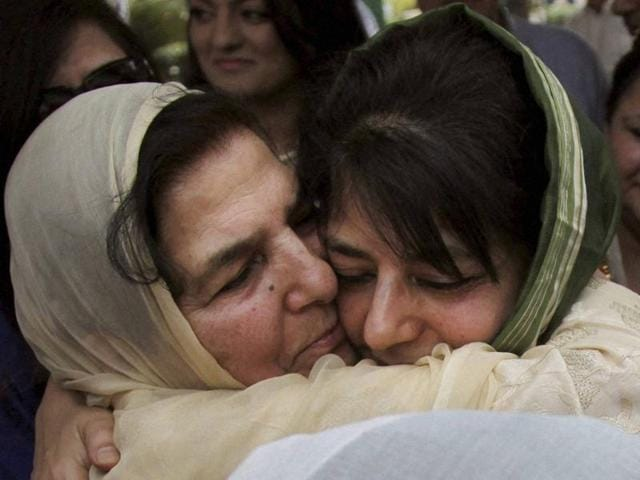 Chief Minister Mehbooba Mufti (R) hugs her mother Gulshan Ara Nazir at a ceremony in Jammu where she was sworn in as Jammu and Kashmir's CM.