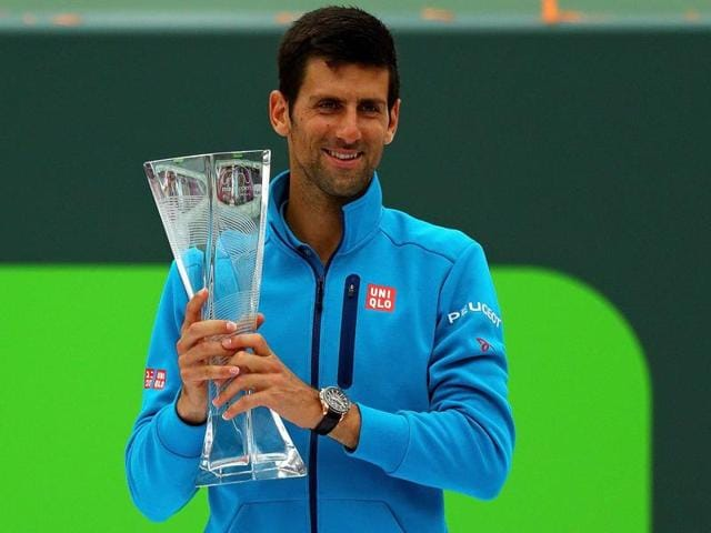 Kei Nishikori of Japan and Novak Djokovic pose for photographers after the final of the Miami Open at Crandon Park Tennis Center on April 3, 2016 in Key Biscayne, Florida.
