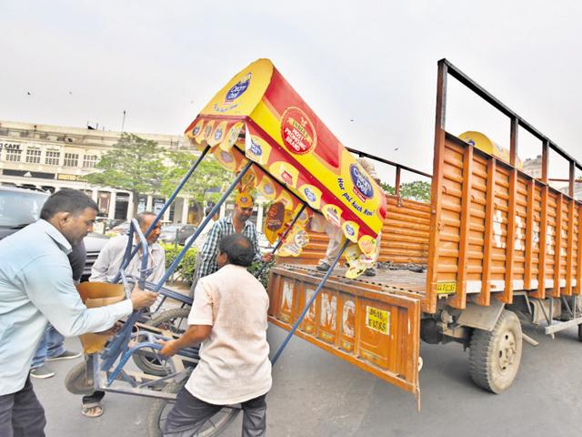 NDMC officials remove an unlicenced ice cream cart from Connaught Place on Sunday.