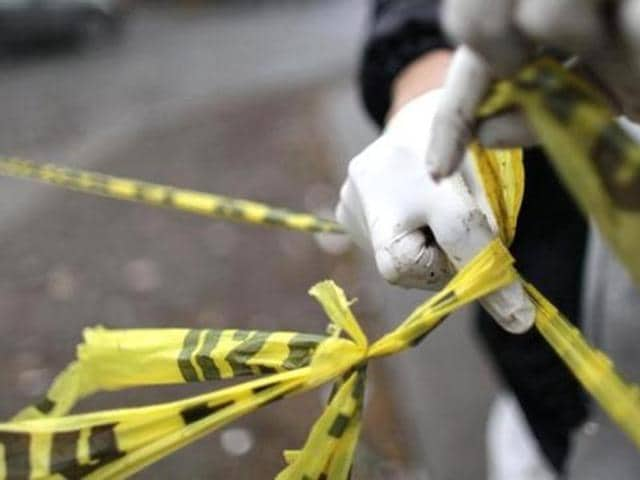 The body was spotted on Sunday near the Samran Rat intersection after a worker at an ice factory found a suitcase containing what looked human remains with a head and shoulders protruding.